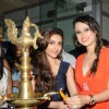 Soha Ali Khan lights the inaugural lamp at the Glamour Jewellery Exhibition with Bulbeer Gandhi