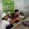 Eesha Koppikar cuts her birthday cake with the  children of Smile Foundation