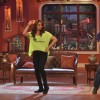 Bipasha Basu performs with a fan on Comedy Nights With Kapil