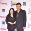 Anu Malik and his wife were seen at the 59th Idea Filmfare Awards 2013
