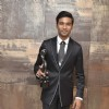 Dhanush holding the black lady at the 59th Idea Filmfare Awards 2013