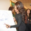 Sonakshi Sinha does a little sketch at the Art show