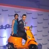 Imran Khan poses on the Vespa S with a fan