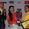 Soha Ali Khan felicitates a winner of the Classmate Spell Bee 2014