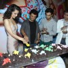 Kangana Ranaut, Vikas Bahl and Rajkummar Rao cut the cake at the Success Party of Queen