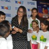 Sonakshi Sinha treats children to cake at a special screeing of Rio 2