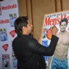 Sidharth Malhotra signs the Men's Health cover