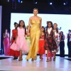 Sushmita Sen walks the ramp at the charity fashion show 'Ramp for Champs'