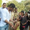 Shahrukh Khan interacts with a fan at a polling station in Mumbai