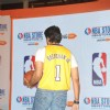 Abhishek Bachchan shows off his jersey at the Launch of NBA's first official online store in India