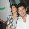 Armaan  and Deeksha enjoying the metro ride  .