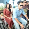 Armaan and Deeksha travelling by cycle rickshaw to avisit Jal Mahal in Jaipur