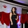 Zareen Khan poses before the launch of Amethyst in India
