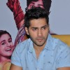 Varun Dhawan posing smartly at the Press Meet