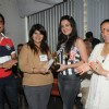 Bharat and Dorris Godambe with Amy Billimoria felicitating a Student