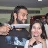 Akhil Kapur and Sasha Agha pose with a gun at the Promotions of Desi Kattey