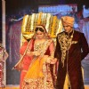 Zarine Khan walks out of a doli at the IIJW 2014 - Day 2