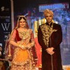 Zarine Khan walks the ramp as a bride at the IIJW 2014 - Day 2