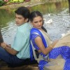 Mohan and Bhakti sitting near a lake
