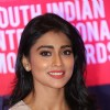 Shreya Saran smiles for the cameras at the Curtain Raiser of SIIMA Awards