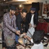 Sharib-Toshi give some money as a token of gratitude at the Sufi Mehfil