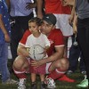 Aamir khan holds a kid at Charity Football Match