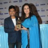 Poonam Dhillon presenting an award at the International Indian Achiever's Award 2014