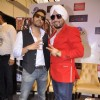 Mika and DJ Dilbagh Singh pose for the media at the Album Launch