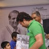 Sachin Tendulkar greets a young fan at Durgapur Tribute Book Launch