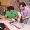 Sachin Tendulkar autographs a book at Durgapur Tribute Book Launch