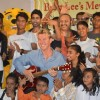 Brett Lee poses with a guitar and with the kids at Mewsic India Foundation