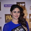 Kareena Kapoor holds a Singham Returns Merchandise at the Launch