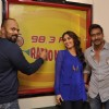 Ajay, Kareena and Rohit pose for the media at Radio Mirchi Studio