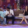 A fan performs an act for Ajay Devgn on Comedy Nights With Kapil