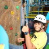Bhavya Gandhi tries his hand on mountain climbing at the Launch of the 10th Planet-Happy Planet