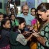 Rani Mukherjee gives autograph to students at the Promotion of Mardaani at a Local School