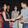 A guest greets Aamir Khan at the Premiere of Makrand Deshpande's Saturday Sunday