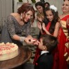Shama Sikander feeds cake to a kid at her Birthday Bash