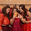 Parvathy Omanakuttan and Daisy Shah pose for a selfie with a fan