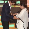 Mamta Bannerjee ties a rakhi to Shah Rukh Khan at a Police Event in Kolkota