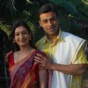 A still image of Anupam Bhattacharya and Payal Nair