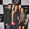 Shilpa Shetty, Shamita Shetty and Raj Kundra pose for the media
