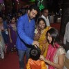 Raj Kundra puts a tilak to his son at Isckon Temple on Janmashtami
