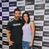 John Abraham and Nargis Fakhri pose for the media at the Press Meet of Reebok