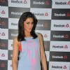 Nargis Fakhri poses for the media at the Press Meet of Reebok