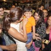 Priyanka Chopra plays with a kid at the Promotions of Mary Kom at Gold's Gym