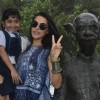 Neha Dhupia clicks a picture with a young fan