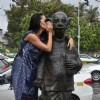 Neha Dhupia says a secret to the comman man's statue of R.K. Laxman