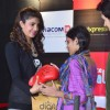 Priyanka Chopra gifts a boxing glove to a fan at the Promotions of Mary Kom at Reliance Outlet