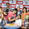 Vivek Oberoi feeds his Birthday cake to a kid